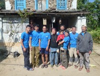 Photo session program with family and friends from France, on the background damaged house of Senior cook Jetha